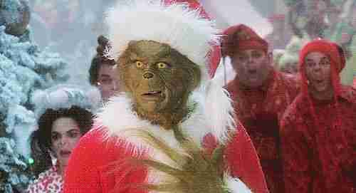 "Jim Carrey en """" The Grinch"" celebrando"